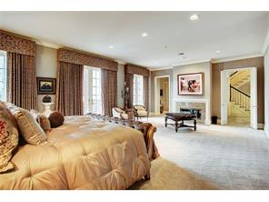 The last of the five fireplaces is located in the master suite which has plush carpeting, built-ins and so much room