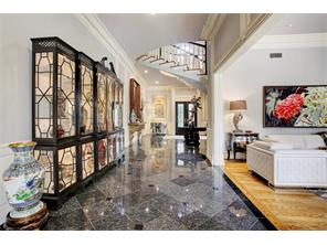 Another view of the entry and hallway looking to the custom, massive front doors accented with crystals