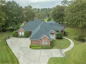 Aerial View of Home and Pool. Home is located on Golf Course, however, the Trees add Privacy to Back Yard.