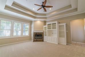 Family Room has Built Ins and Fireplace. This Casual Area is Perfect for Gathering the Friends to Watch a Movie.
