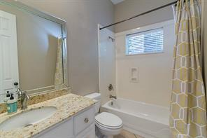 Full Bath Located in Hall Outside of Fourth Bedroom.
