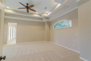 Master Suite is Perfectly Located with Views and Entrance to Back Yard and Pool.