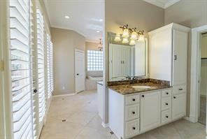Master Bath has Separate Vanities, Private Toilet Room, Soaking Tub, Large Shower and a Walk In Closet Perfect for All of HIs Golf Clothes. Don t Worry...There is Plenty of Space for Two!