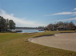 This beautiful golf course lot is located on Miller #8.  This is a par 3 hole with lots of sand traps and water behind the green.  The cart path is located on the other side of the fairway.