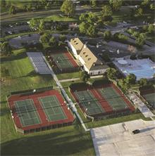 This is the Sports Club with its tennis courts and lap lane pool.