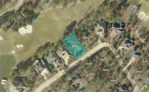 This aerial view shows the location of the lot on the fairway.  There are 2 lots between the houses.