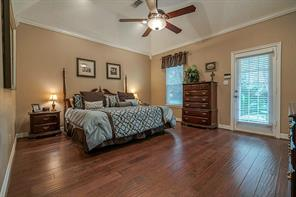 Plenty of room for extra furniture pieces in the master bedroom. (Shown with furniture)