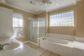 Master bath has a jetted tub, linen closet & walk-in closets.