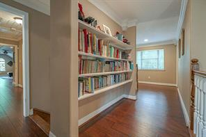 Hallway upstairs has built-ins for storage/books.