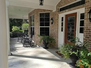 Fantastic front porch for a swing and rocking chairs, a place to relax and watch the wildlife.