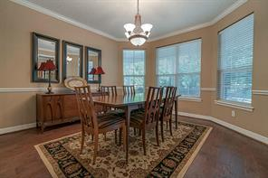 Formal dining with furniture to show the space.