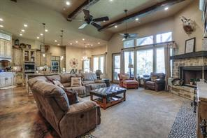 Spacious open floorplan with cedar beams and big windows to enjoy the lake view.
