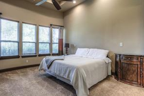 Master bedroom is on the main floor and has recessed lighting, big windows to enjoy the lake view, ceiling fan and a 5-piece bath.