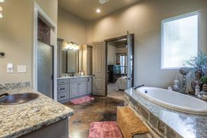 Fantastic master bath has tall sink cabinets, large walk-in shower, full-size jetted tub and 2 large walk-in closets.
