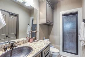 Guest bath with granite counters & shower.