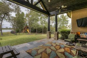 Fantastic huge covered slate porch offers great area to entertain outdoor-style; features outdoor kitchen with ice maker.