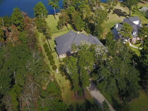 Aerial shows home backing to Majestic Lake. It's a beautiful home on the water, ready for you!