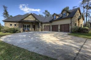 Magnificent front view of the stone and stucco exterior of the home. The garage is over-sized and there is a nice front porch to enjoy. Make this your next home!