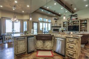 Kitchen features double ovens PLUS warming drawer, huge pantry, under cabinet lighting, built-in fridge, gorgeous granite, drop lighting and bar seating at the island.