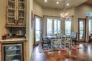 Beautiful views out the windows while you enjoy your meal. Cabinets for storage and a huge pantry. Dry bar set up with wine fridge space, perfect for entertaining.