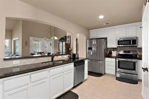 Beautiful kitchen includes custom cabinets, granite countertops, oil rubbed bronze fixtures, stainless appliances, can lights and lots of cabinet space.