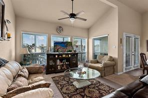 Spacious living room includes tall ceilings, lots of natural light.