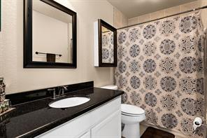 Full size downstairs bathroom. Custom cabinets, granite counter tops, oil rubbed bronze fixtures and tile set shower.