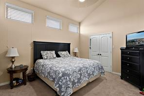 Large master bedroom with large closets and tall ceilings.