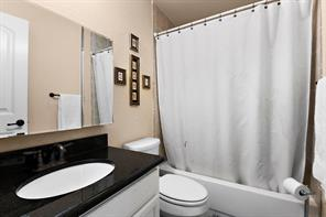 Second full size bathroom includes mud set tile shower, granite countertop, custom cabinet and large medicine cabinet.