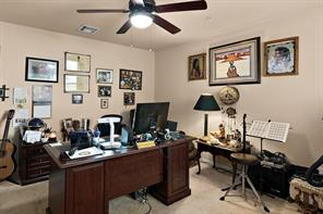 Downstairs bedroom being used as an office.