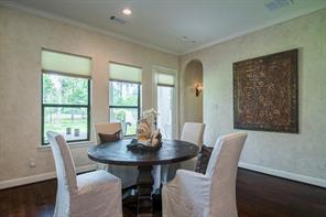 Large breakfast room for mornings and casual meals. Downstairs guest suite is through the archway.
