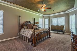 Escape to the master suite with plush carpeting and sitting area.