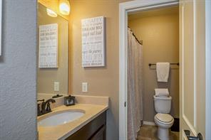 The secondary bathrooms are also nicely finished with stone counters and stained cabinetry.