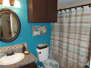 2nd full bath off of living area with new granite, mirror, faucet, toilet and light fixture.