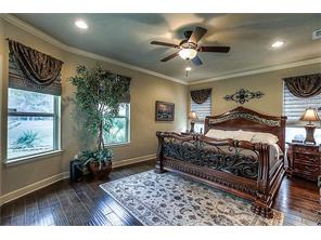 The classy Master Bedroom. Notice the beautiful window treatments through out the home.