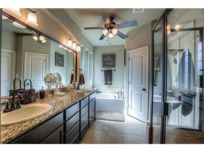 The Master Bath with dual vanities and separate tub and shower