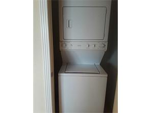 Stack washer and dryer are included with this condo.