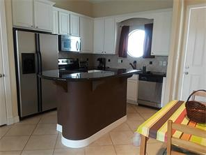 Nice eat in kitchen with stainless appliances and granite counter tops.