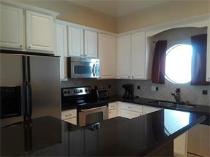 Stainless appliances, granite counter tops and tile floor complete this kitchen!
