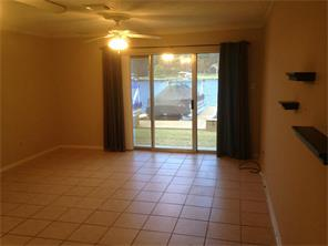 large open concept living and dining - yes that is Lake Conroe out the door.
