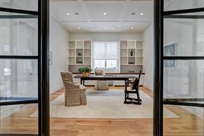 The Study, Elevator and Powder Room Hall leads to the Family Room.