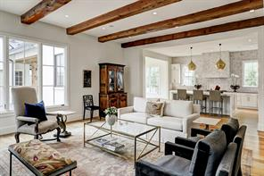 The spacious and light-filled FAMILY ROOM (22'x20') has an Isokern fireplace with gas and wood options, and Douglas Fir beams which add great character to this room.