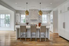 The KITCHEN is centrally located and allows you to be part of what goes on in the Family and Breakfast Rooms.