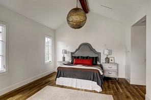 This photo showcases the Master Suite's high vaulted ceilings with a central beam as well as the wonderful white oak floors.