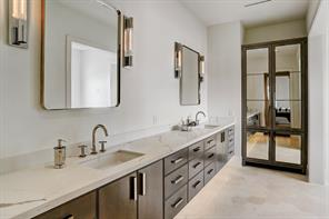 Stylish MASTER BATHROOM in neutral tones, plenty of counter and storage space, double sinks, freestanding tub and spacious walk-in shower.