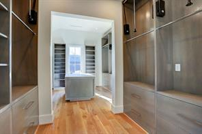 The glass-front linen closet adds more storage and also makes the Master Bathroom feel even larger.