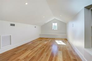 It features vaulted ceilings, recessed lighting and a wall of built-ins which offers good storage space,