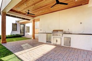 Alternate view of the back yard and summer kitchen.