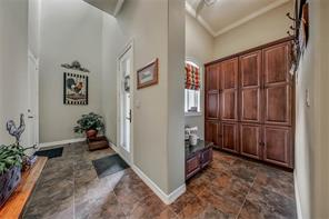 Behind the kitchen is the side entrance to the home complete with coat closet and mud area for organizing backpacks, shoes and jackets. Stylishly organize and store umbrellas, dog leashes and all those items you need to grab on your way out the door.