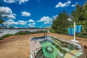 After a long day, grab a drink and enjoy the view while soaking in your hot tub! Blooming gardens, steaming water, cool drinks and backyard bliss! What a way to end a round of golf!